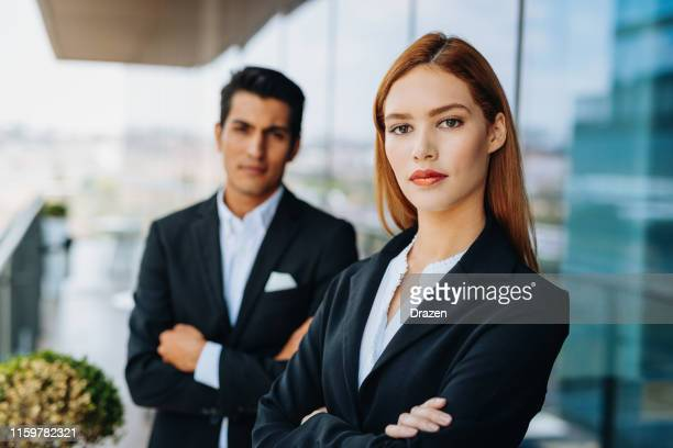 portrait of beautiful and successful millennial business people - latina leader in business - ginger banks stock pictures, royalty-free photos & images