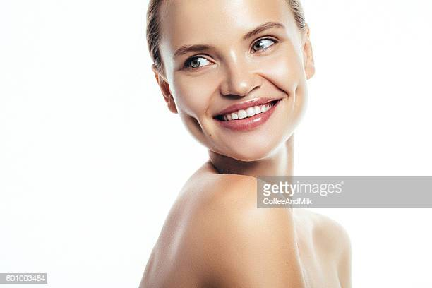 Portrait of beautiful and young smiling girl