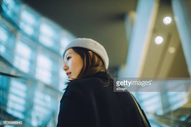 Portrait of beautiful Asian woman looking forward in deep thought