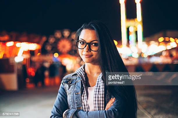 Portrait of beautiful asian woman with eyeglasses in amusement park