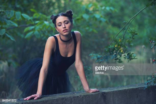 portrait of beautiful ballerina with closed eyes standing in nature - short necklace stock photos and pictures