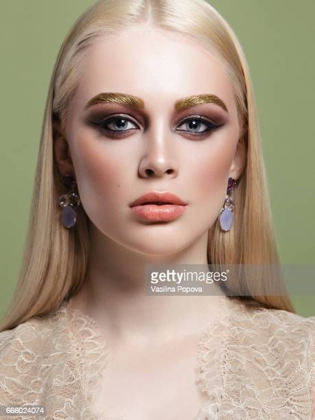 portrait of beautiful blonde woman - champagne coloured stock photos and pictures