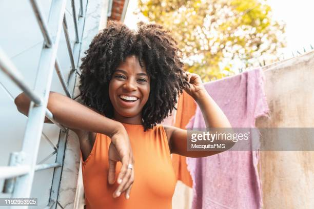 portrait of beautiful brazilian afro woman relaxing outside the house - adults only stock pictures, royalty-free photos & images