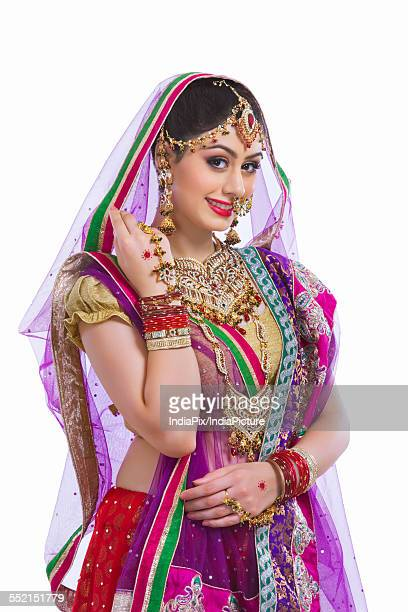 Portrait of beautiful bride smiling against white background