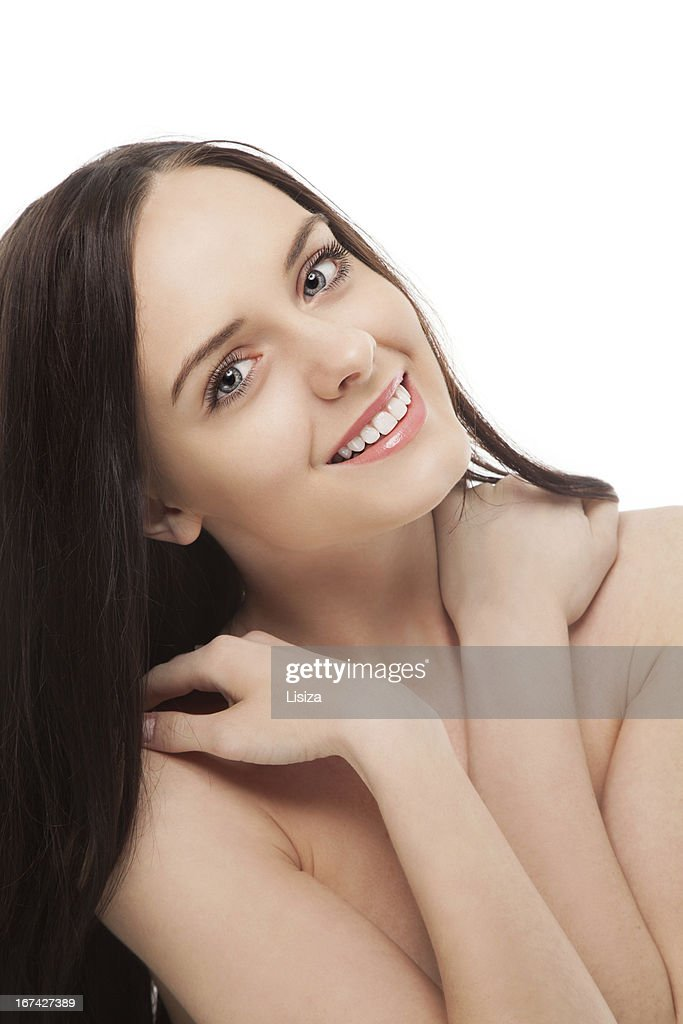 portrait of beautiful brunette smiling girl holding hands on her : Stock Photo