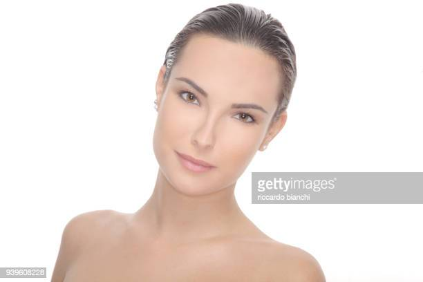 portrait of beautiful brunette woman with clean face and little smile