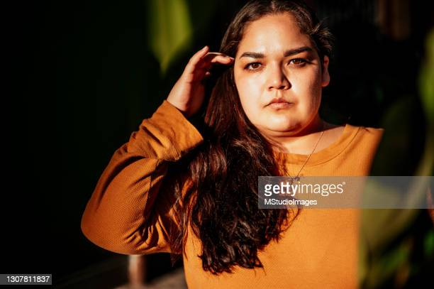 portrait of beautiful but serious woman - plus size model stock pictures, royalty-free photos & images