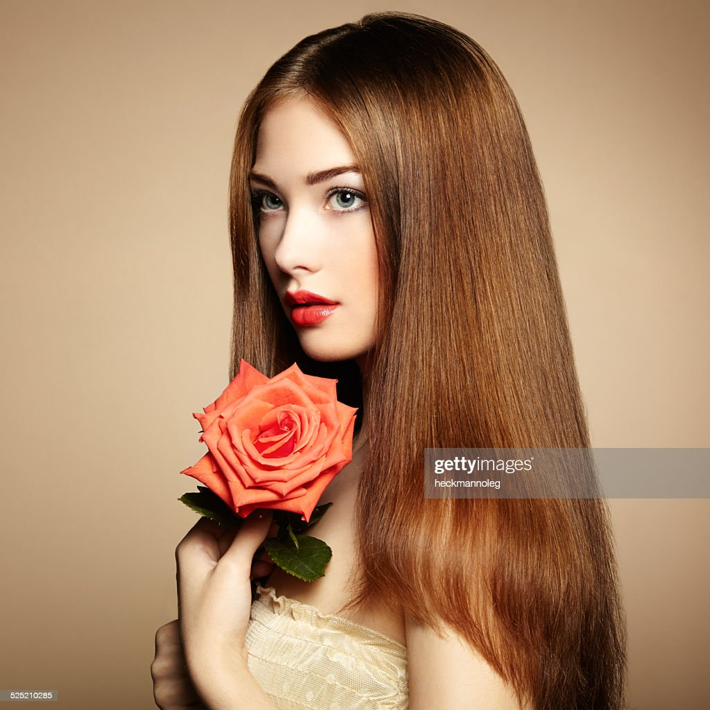 Portrait of beautiful darkhaired woman with flowers stock photo portrait of beautiful dark haired woman with flowers stock photo izmirmasajfo