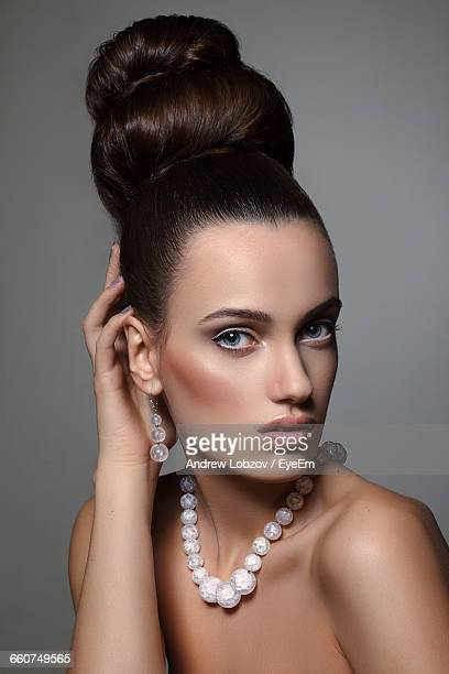 Portrait Of Beautiful Fashion Model Against Gray Background