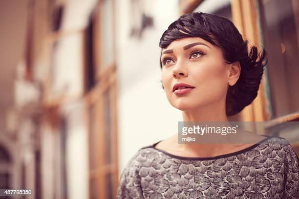 Portrait of beautiful fashion model posing outdoors