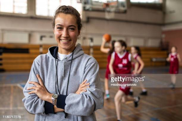 portrait of beautiful female basketball coach - coach stock pictures, royalty-free photos & images