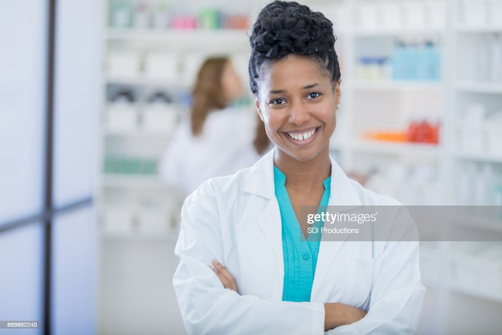 Portrait of beautiful female pharmacist : Stock Photo