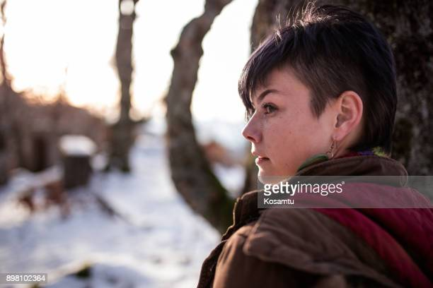 portrait of beautiful frozen young woman - half shaved hairstyle stock photos and pictures