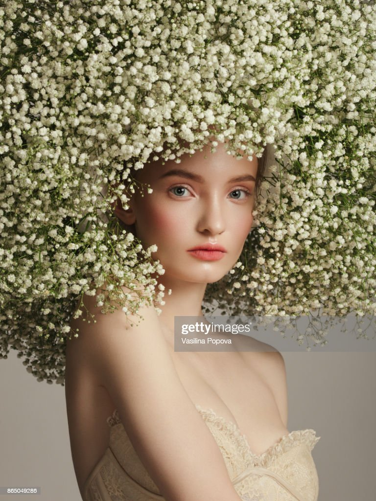 Portrait of beautiful girl with flower wreath stock photo getty images portrait of beautiful girl with flower wreath stock photo izmirmasajfo