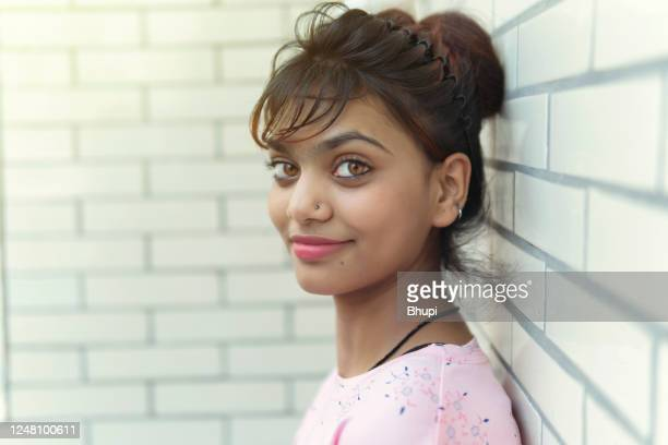 portrait of beautiful happy young woman looking at camera. - 18 19 years stock pictures, royalty-free photos & images