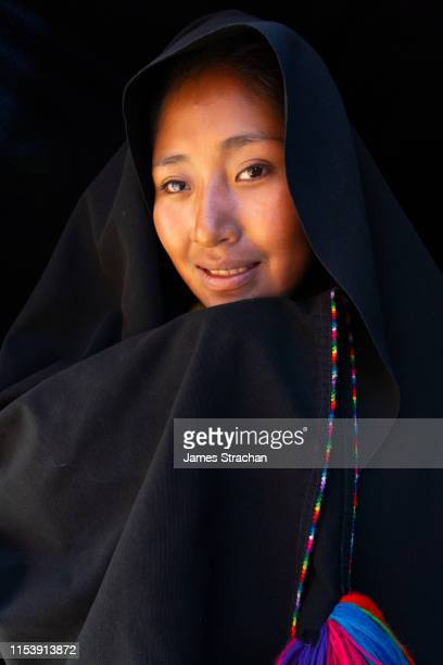 portrait of beautiful local woman in traditional, simple local clothing (including black head shawl), taquile island, lake titicaca, peru (model release) - james strachan stock pictures, royalty-free photos & images