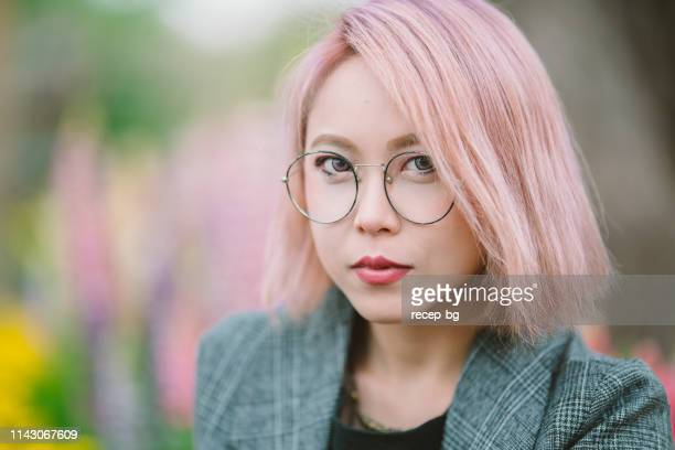 portrait of beautiful millennial generation woman with pink hair - pink hair stock pictures, royalty-free photos & images