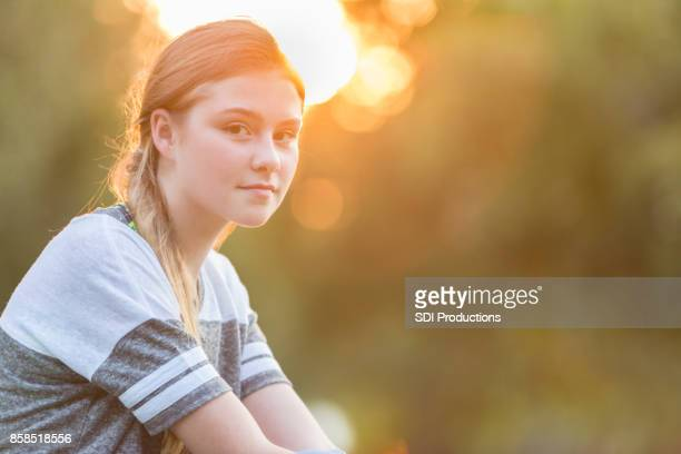 Portrait of beautiful preteen girl at sunset