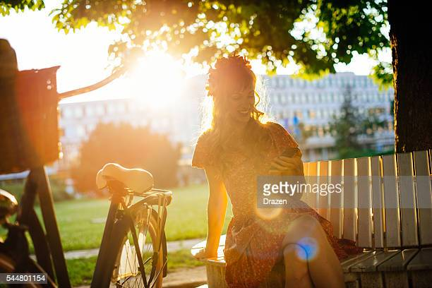 Portrait of beautiful red head woman with vintage bicycle