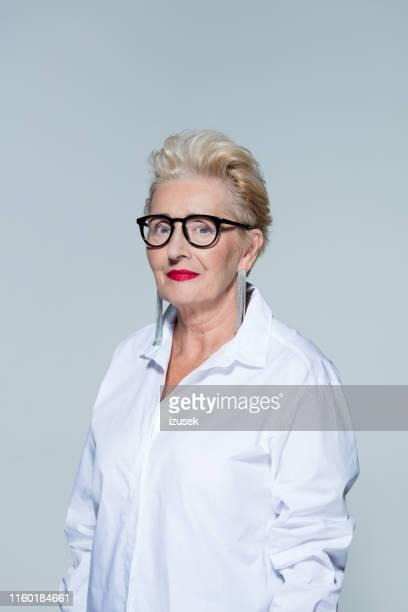 portrait of beautiful senior businesswoman - izusek stock pictures, royalty-free photos & images