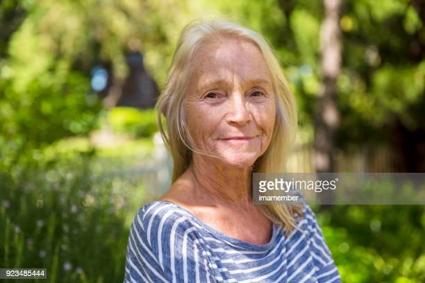 Portrait of beautiful senior woman in the park, copy space