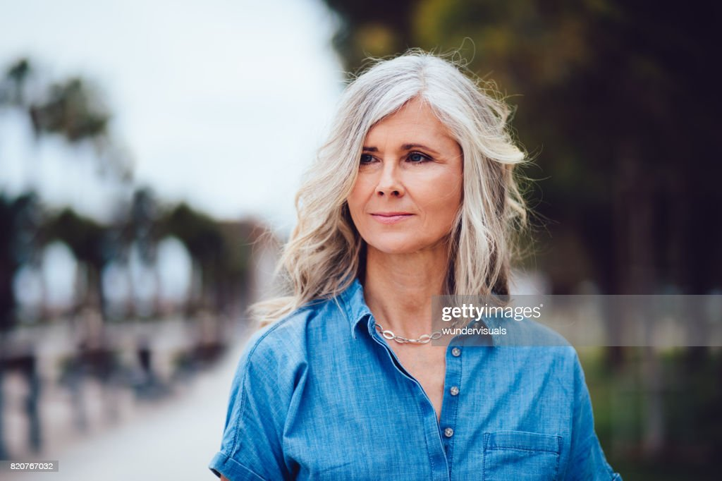 Portrait of beautiful senior woman with grey hair outdoors : Stock Photo