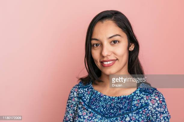 portrait of beautiful smiling mexican millennial woman - mexican ethnicity stock pictures, royalty-free photos & images