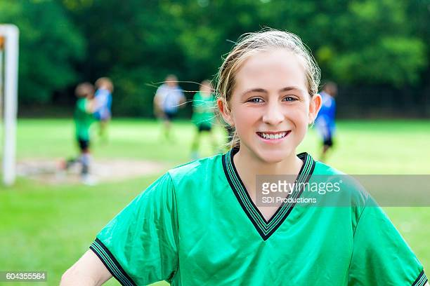 Portrait of beautiful teenage female soccer champion