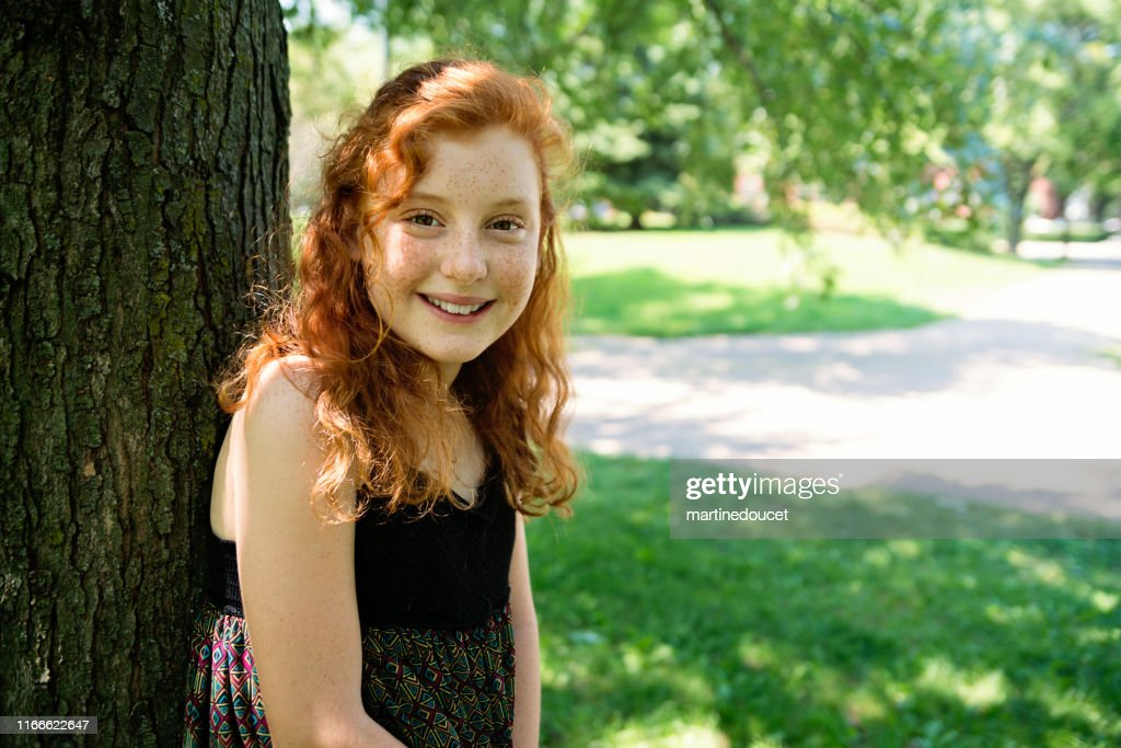 Portrait of beautiful teenage girl in a park. : Stock Photo