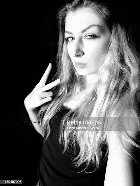 portrait of beautiful woman against black background - elena knouzi stock pictures, royalty-free photos & images