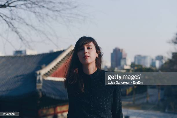 Portrait Of Beautiful Woman Against Sky
