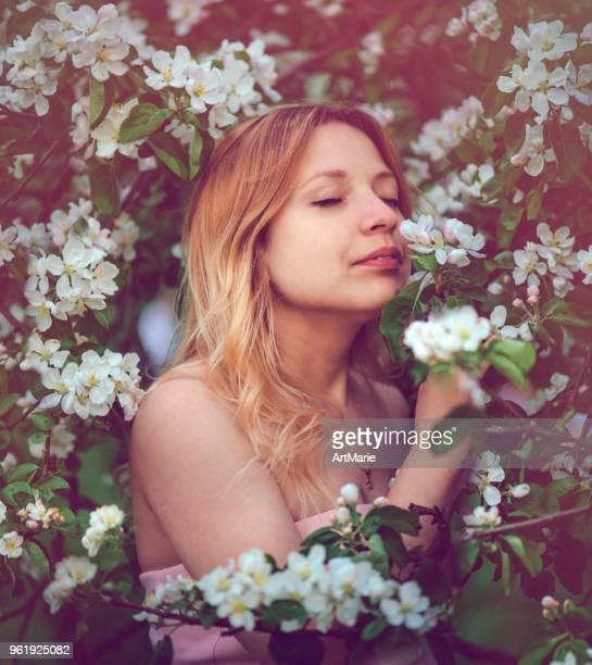 Portrait of beautiful woman in blooming garden
