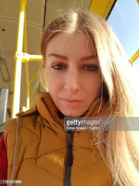 portrait of beautiful woman in bus - elena knouzi stock pictures, royalty-free photos & images