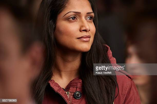 portrait of beautiful woman in crowd, looking out - femme indienne photos et images de collection