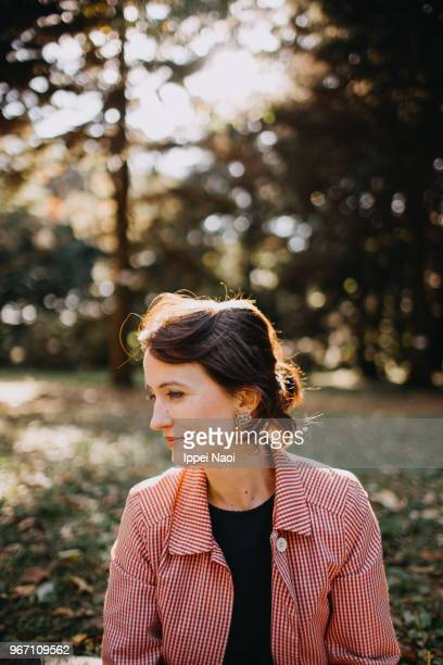 portrait of beautiful woman in nature in autumn - one mid adult woman only stock pictures, royalty-free photos & images