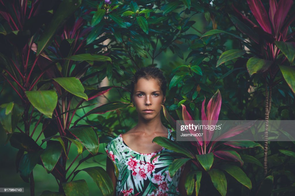 Portrait of beautiful woman in rainforest : Stock Photo