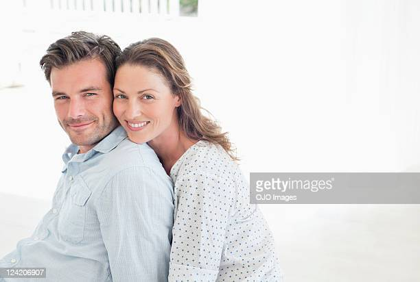 Portrait of beautiful woman smiling and leaning on her boyfriend's shoulders