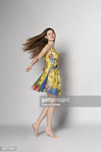 portrait of beautiful woman spinning against white background - cut out dress stock pictures, royalty-free photos & images