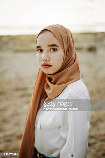 portrait of beautiful woman standing outdoors - indianapolis stock pictures, royalty-free photos & images