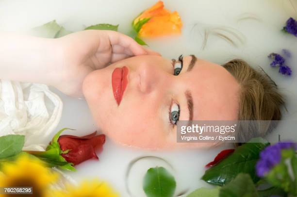 Portrait Of Beautiful Woman Taking Milkbath At Spa