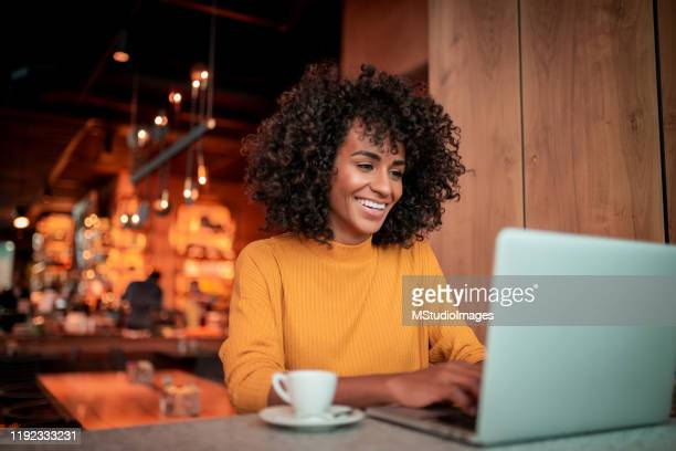 portrait of beautiful woman using a laptop - using laptop stock pictures, royalty-free photos & images