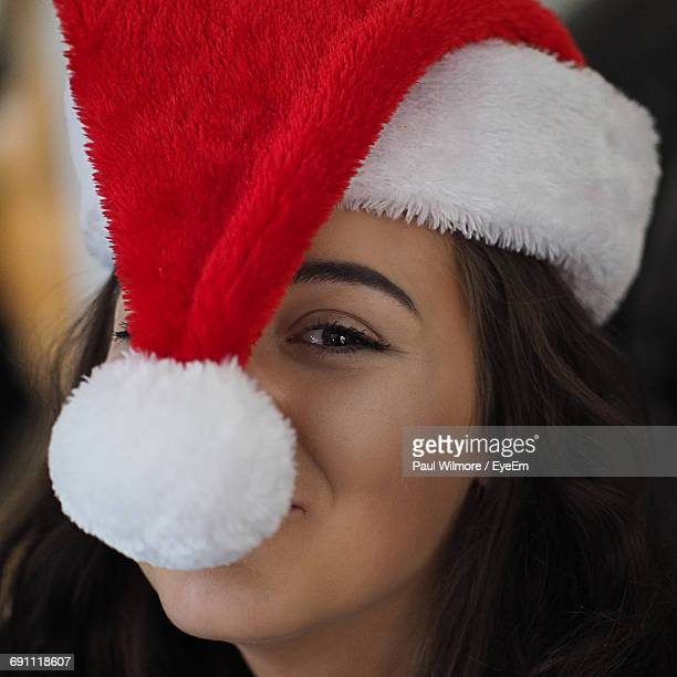 Portrait Of Beautiful Woman Wearing Santa Hat