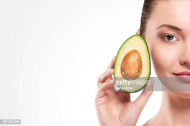 Portrait of beautiful woman with an avocado. Debica, Poland