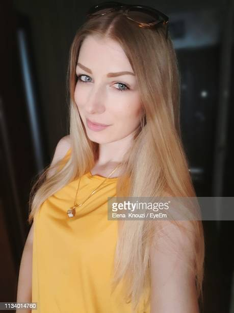 portrait of beautiful woman with blond hair - elena knouzi stock pictures, royalty-free photos & images