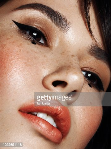 portrait of beautiful woman with cat eye makeup highres