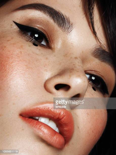 portrait of beautiful woman with cat eye make-up - stage make up stock photos and pictures