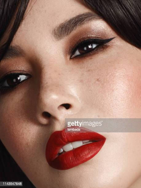 portrait of beautiful woman with cat eye make-up - red lipstick stock pictures, royalty-free photos & images