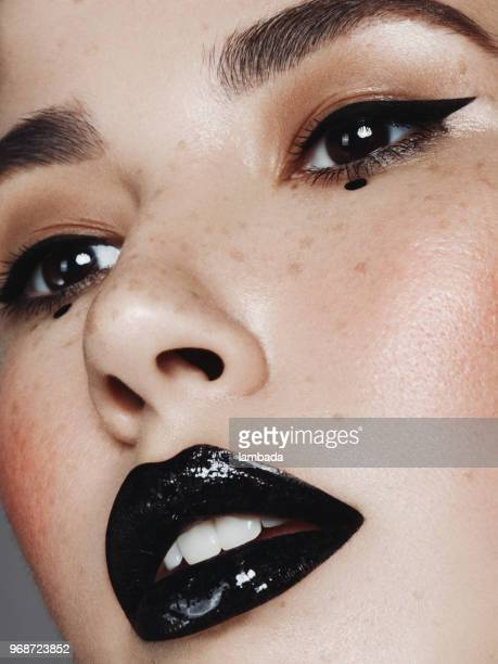 portrait of beautiful woman with cat eye make-up - eye liner stock photos and pictures