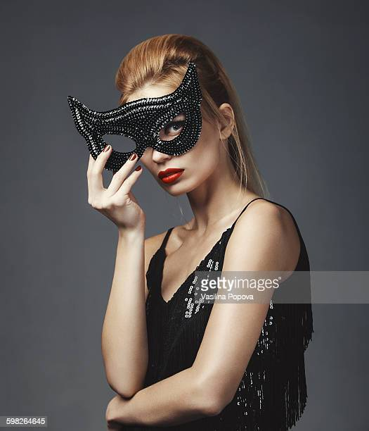 Portrait of beautiful woman with cat mask