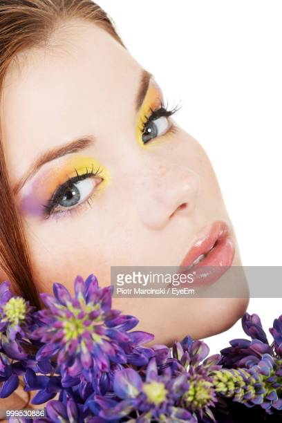 portrait of beautiful woman with flowers against white background - アイメイク ストックフォトと画像